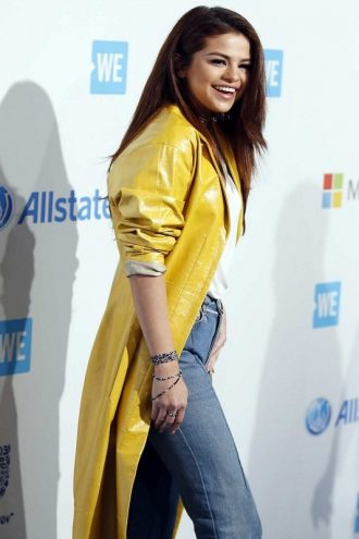 Singer Selena Gomez Yellow Leather Coat